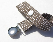 "Brown with funky white ""stitching"" Soother Clip, Pacifier Clip, Toy Tether - Gender Neutral"