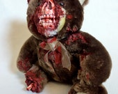 UndeadTed with missing leg and chewed off face. Gross.