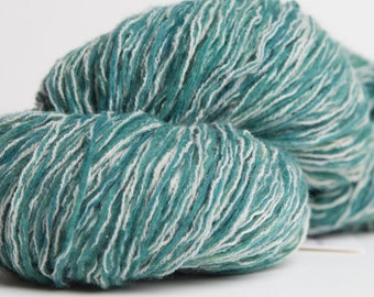 Recycled kettle-dyed light worsted weight lambswool/acrylic/nylon yarn - green/beige - approx 79 yds