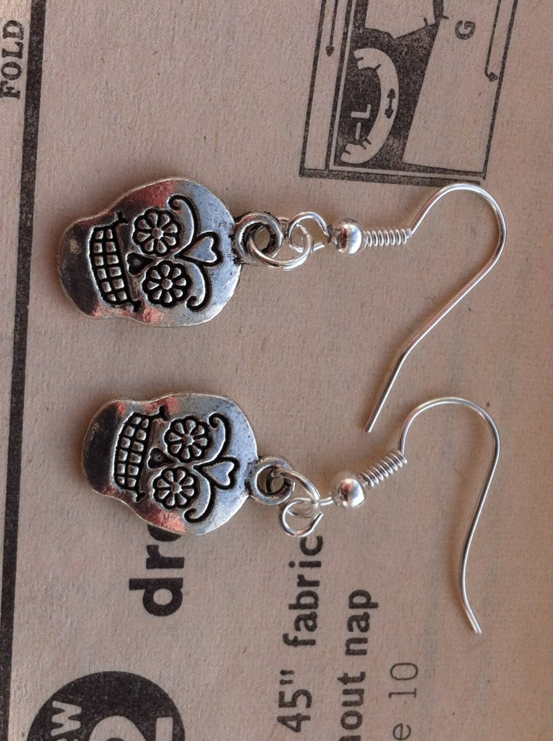 sugar skull earrings by madebydustymiller on etsy