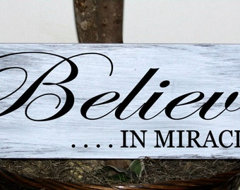 Believe in miracles wood sign