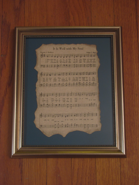 Antiqued Hymn Sheet Music In Frame