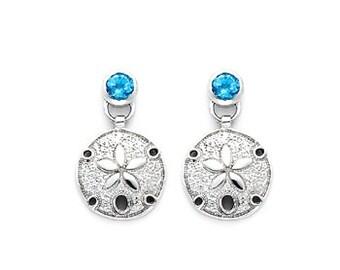 Sterling Silver Sand Dollar Earrings dangle from 0.60 carats of bezel set London Swiss Blue Topaz Stones