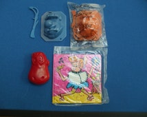 Fruity Pebbles Cereal Wilma and Bam Bam Puzzles Fred Flinstone Ice molds Dino Plastic Head