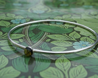 Handmade silver bangle with green amber stone