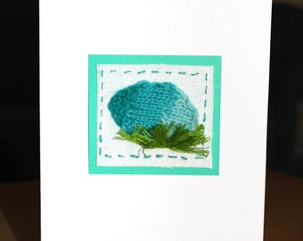 Knitted Easter egg hiding in grass card