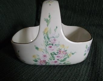 vintage floral design ceramic basket with a gold trim.
