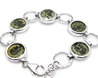 """Ancient coin jewelry,""""Roman bronze coins"""",set in silver bracelet."""