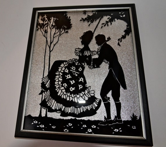 Vintage Silhouette Of Couple Swinging