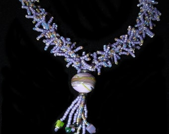 Fringed spiral necklace with focal bead