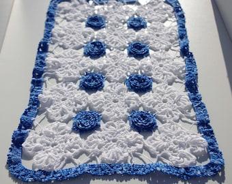 Crochet doily blue flowers