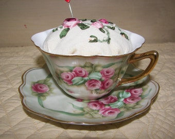 Hand embroidered silk ribbon pincushion in a vintage teacup