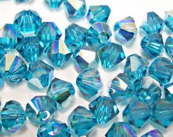 Swarovski Crystal Xilion 4mm Blue Zircon AB color / 229 AB (100 pcs)