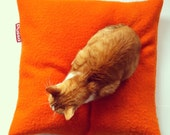 Pussa feel good cushion, orange, medium 60 x 60cm, cover made of 100% reused wool and washable hypoallergenic filling.