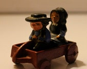 Antique Cast Iron Toy by Dalecraft - Amish Children Boy and Girl on Little Red Wagon - Marked 311 - 1920s