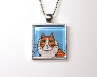 SALE... Orange Tabby Persian Cat Glass Pendant in Silvertone Setting,  Blue Background