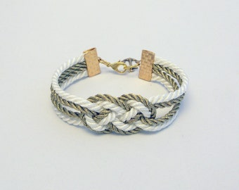 Ivory cream and metallic gold double infinity knot nautical rope bracelet with gold anchor charm
