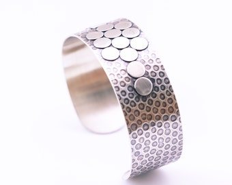 "Recycled silver cuff with a playful design of light and dark circles in a multidimensional and oxidized arrangement - ""Adagio Cuff"""