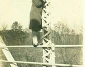 1920s Flapper Woman Standing on Railing of Highway River Bridge Antique Black White Vintage Photo Photograph