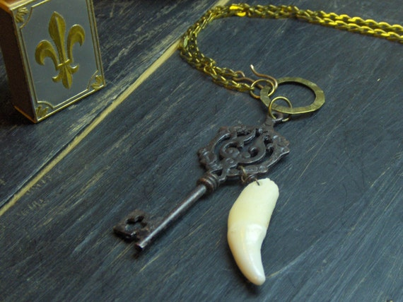 The Wolf at My Door.  Antique style Skeleton key and coyote tooth rustic talisman unisex necklace.