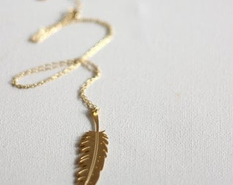 Gold charm necklace, feather