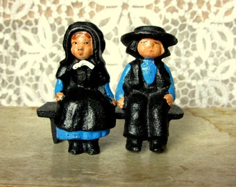 Vintage Amish Dolls, Cast Iron, Hand Painted, Boy and Girl Dolls Sitting on a Bench, Man and Woman