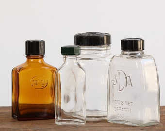 A Set of 4 Vintage French Pharmacy Apothecary Medicine Bottles