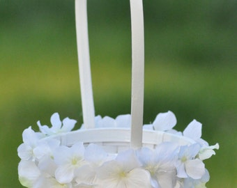 Wedding Flowers, White hydrangea flower girl basket.
