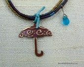 Mauve Hand Painted Embossed Metal Umbrella Pendant on Three Strands of Glass Seed Beads