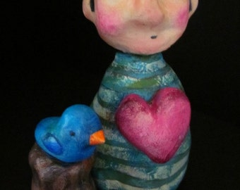 Man With Heart and Bird Clay Sculpture
