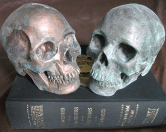Life-size HUMAN SKULL SCULPTURE, coated with antique bronze or copper