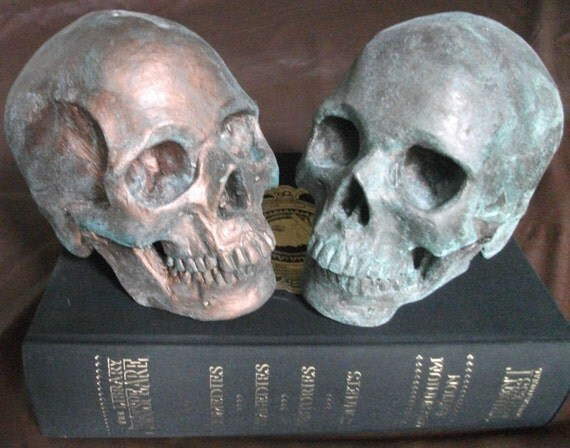 HUMAN SKULL SCULPTURE: life-size cast coated with antique bronze or copper