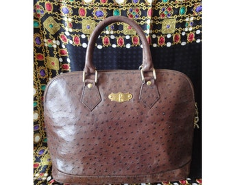 70s, 80s Vintage Roberta di Camerino ostrich embossed brown leather bag in Alma style  with gold tone R charms. Rare piece from RDC.