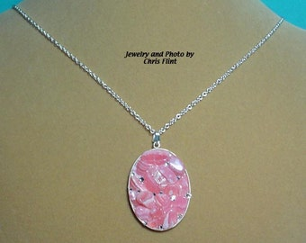 Dazzle them with this Rhodochrosite and Swaroski Crystal Pendant. - N101