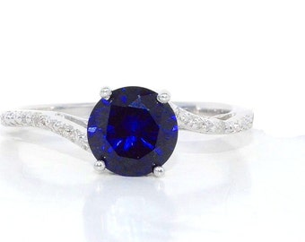 14Kt White Gold Blue Sapphire & Diamond Round Ring