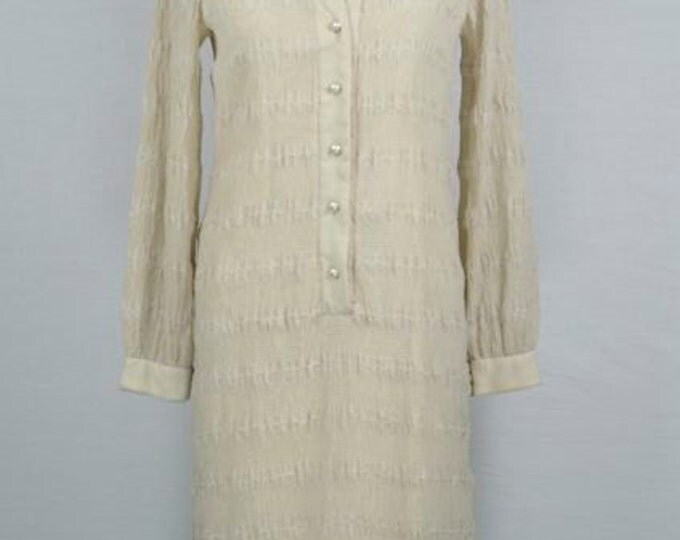 Vintage 1960s long sleeve beige wiggle dress and pearl buttons