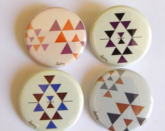 4 blue and purple pattern badges