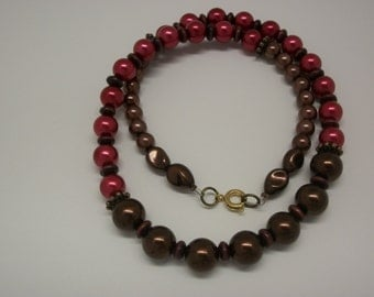 Rasberry and chocolate pearl necklace.