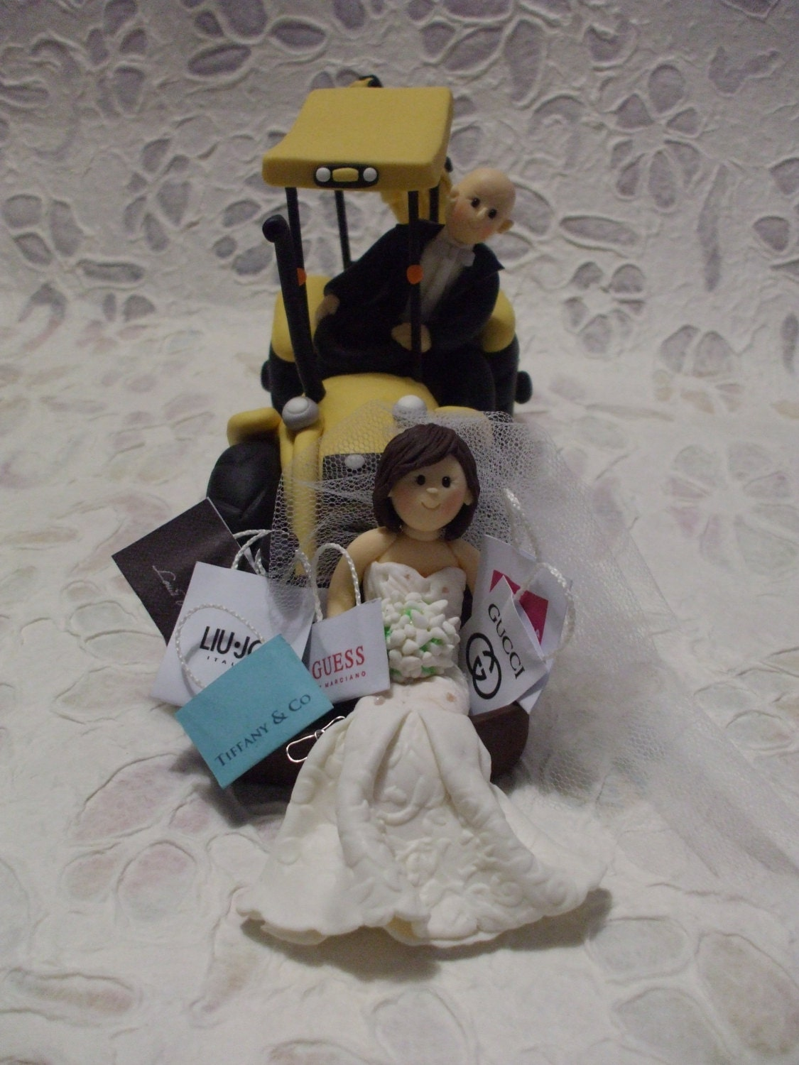 Customized bride and groom on excavator wedding cake topper