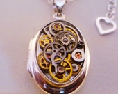 Sterling silver locket necklace with free gift.