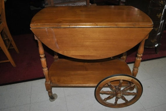 Antique Dresser With Mirror On Wooden Wheels
