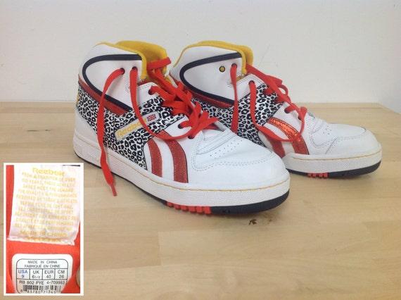 b31da88a46bd Reebok classic high tops with animal print red glitter jpg 570x426 Reebok  high top sneakers animal