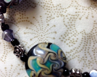 Beaded Lampwork Bracelet Turquoise,Black, Gold and Purple Swtirling Colors