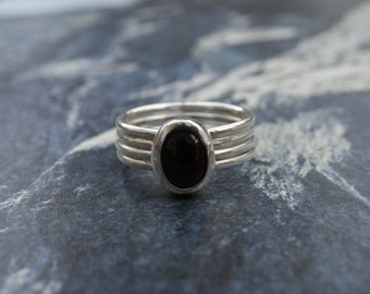 Handmade Sterling silver four band ring with cabochon set garnet gemstone