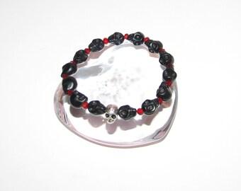 Black Howlite skull stretch bracelet with red crystal beads