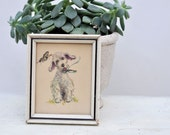 vintage print of dog with butterfly