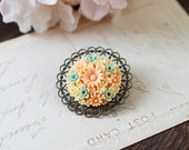 Celluloid Floral Brooch Pin. Flower Bouquet Antique Brass Lace Filigree Brooch. Blue Orange Pink and Ivory Flowers Brooch
