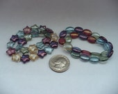 Czech Pressed Glass Gossamer Oval Or Star 25 Bead Strand