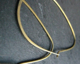 modern minimalist hoops in hammered gold tone brass, edgy thin oval hoop earrings, geometric egyptian inspired earrings