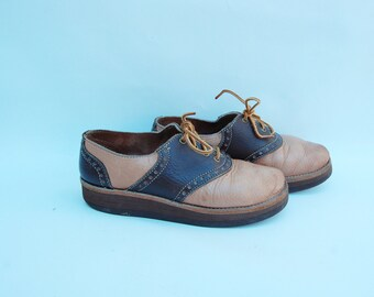 tan and brown SADDLE shoes 7